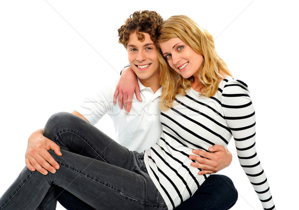Female friend sitting on her boyfriends lap Stock photo © stockyimages