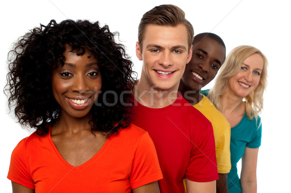 Gruppo amici piedi dietro uno un altro Foto d'archivio © stockyimages