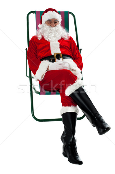 Isolated aged Santa relaxing. Vacation time Stock photo © stockyimages