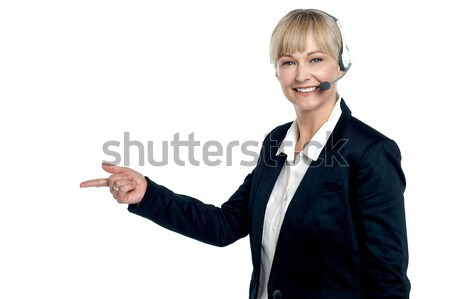 Female customer care agent in a conversation Stock photo © stockyimages