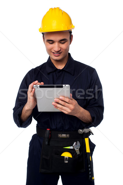 Field worker accessing touch pad Stock photo © stockyimages