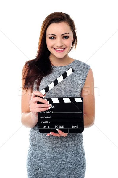 Attractive woman with clapperboard Stock photo © stockyimages