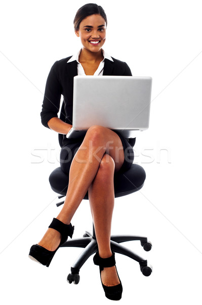 Corporate lady working on her laptop Stock photo © stockyimages