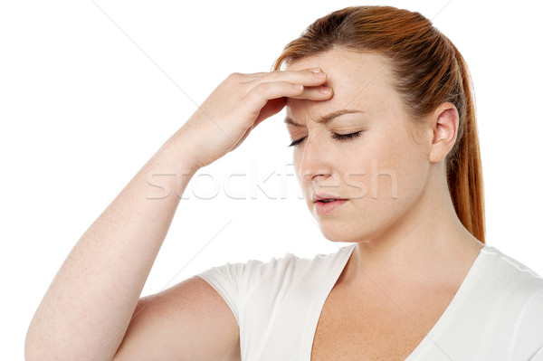 Woman having severe headache Stock photo © stockyimages