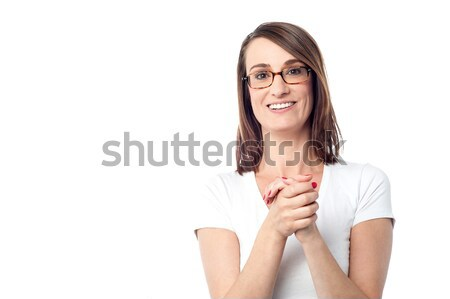 Attractive woman with her hands clasped Stock photo © stockyimages