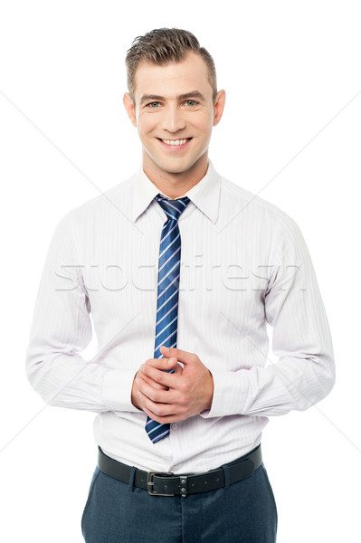 Corporate man posing with clasped hands Stock photo © stockyimages