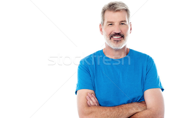 Casual man standing with his arms crossed Stock photo © stockyimages