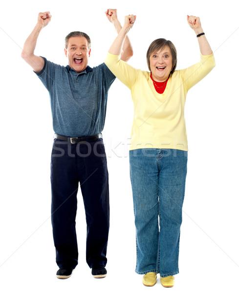 Izgatott idős pár karok a magasban izolált fehér portré Stock fotó © stockyimages