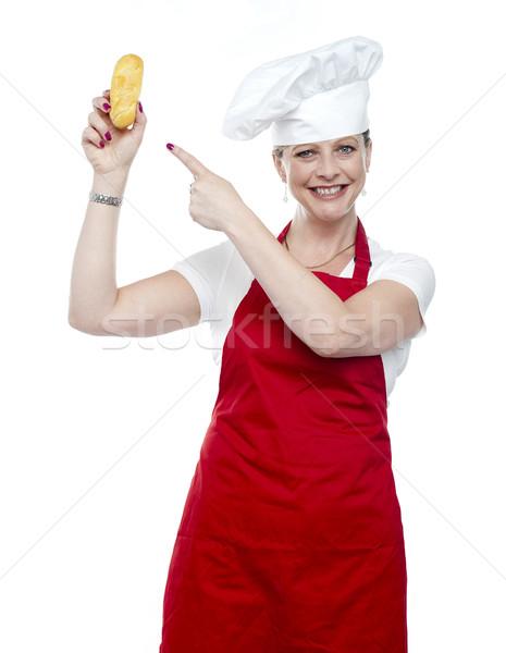 Competente femminile cuoco punta pane isolato Foto d'archivio © stockyimages