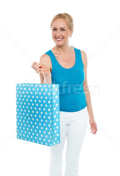 Shopping woman carrying bag, enjoying sale Stock photo © stockyimages