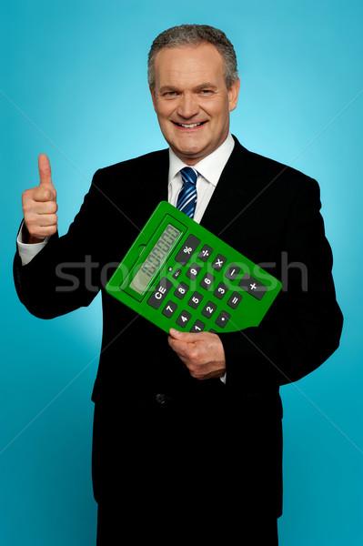Zakenman tonen calculator alle Stockfoto © stockyimages