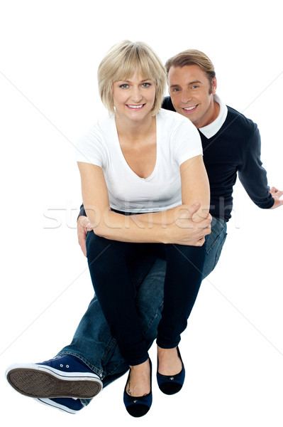 Middle aged lady sitting on her man's lap Stock photo © stockyimages