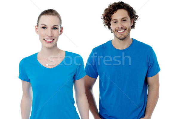 Couple in blue t-shirts. Isolated over white. Stock photo © stockyimages