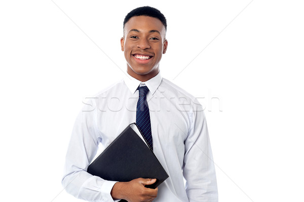 Young businessman holding business file Stock photo © stockyimages