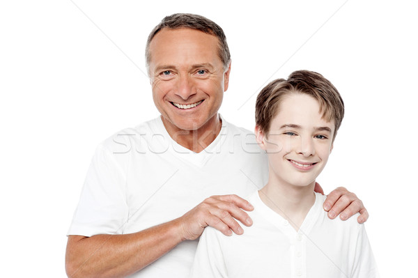 Stock photo: Cheerful mature father and son posing
