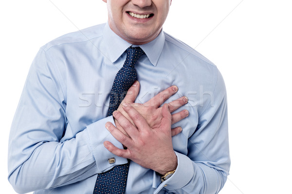 Man has sudden heart attack. Stock photo © stockyimages