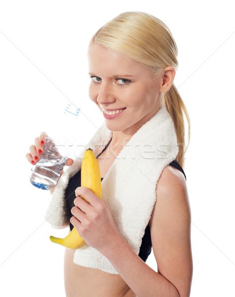 Fitness nina cantimplora plátano toalla Foto stock © stockyimages