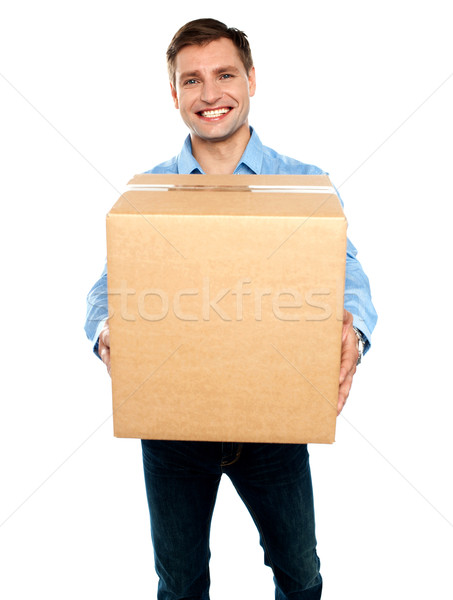 Casual guy carrying packed cardboard boxes Stock photo © stockyimages