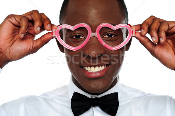 Smiling man wearing heart shaped eye-wear Stock photo © stockyimages