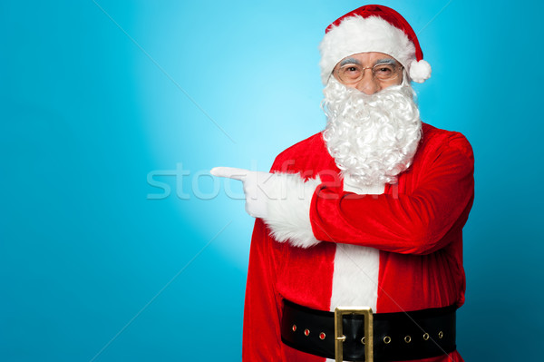 Saint Nicholas pointing sideways, copy space area Stock photo © stockyimages