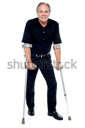 Senior citizen taking his first steps after his successful surgery Stock photo © stockyimages