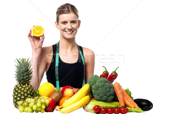 Beautiful girl frutas legumes menina Foto stock © stockyimages