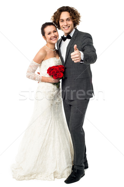 Groom with his bride showing thumbs up sign Stock photo © stockyimages