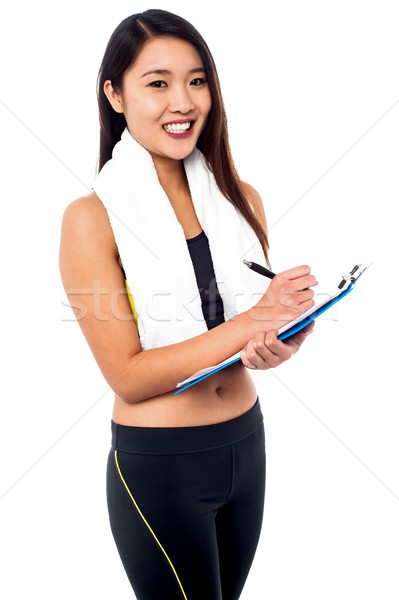 Female dietitian preparing diet chart Stock photo © stockyimages