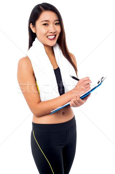 Feminino dietista dieta traçar jovem esbelto Foto stock © stockyimages