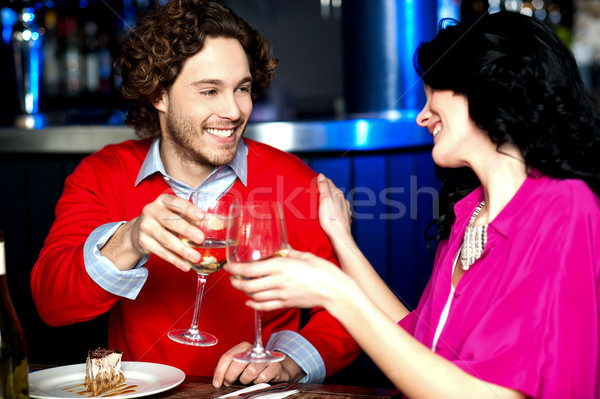 Cheers! Couple celebrating their love together Stock photo © stockyimages
