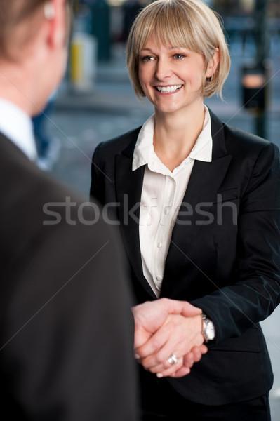 Dois corporativo aperto de mãos pessoas de negócios tratar mãos Foto stock © stockyimages