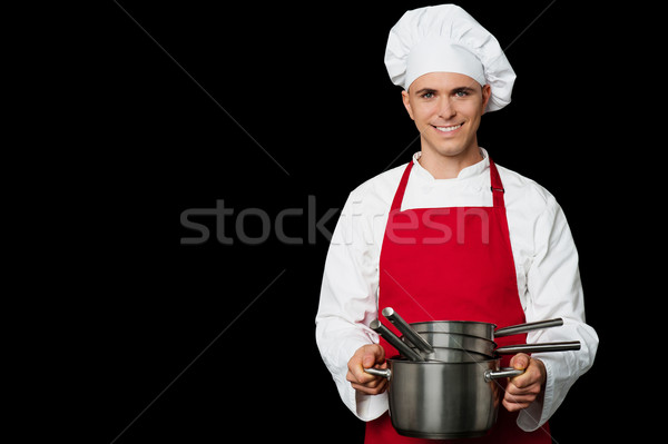 Young chef holding empty vessels in hands Stock photo © stockyimages