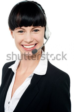 Female telemarketer with headsets Stock photo © stockyimages