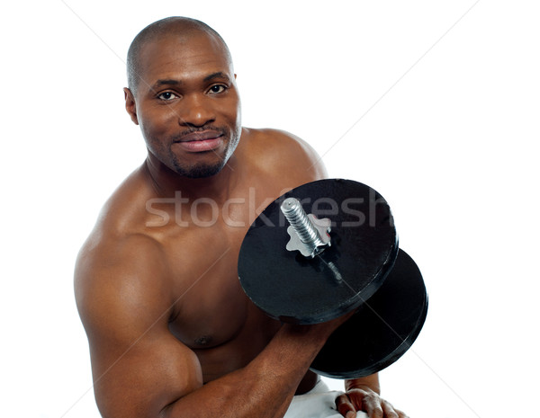 Powerful young man lifting weights Stock photo © stockyimages