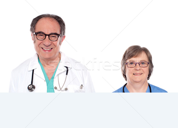 Medical representatives with blank banner ad Stock photo © stockyimages