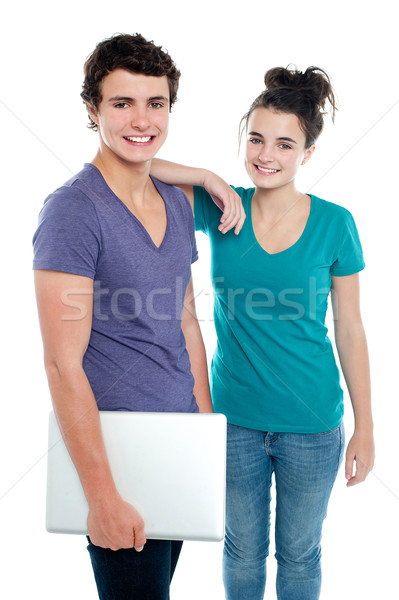 Handsome guy holding laptop posing with his girlfriend Stock photo © stockyimages