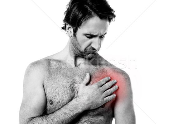 Jonge man borst pijn lijden medische gezondheid Stockfoto © stockyimages