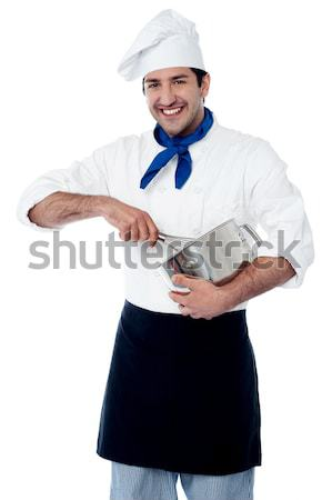 Experienced male chef using egg beater Stock photo © stockyimages