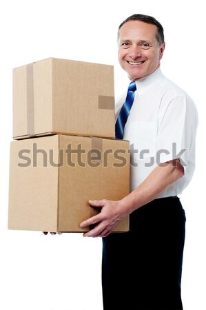 Smart young man carrying boxes Stock photo © stockyimages