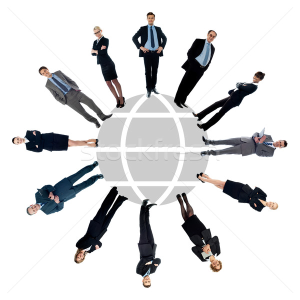 Business people around the world map Stock photo © stockyimages