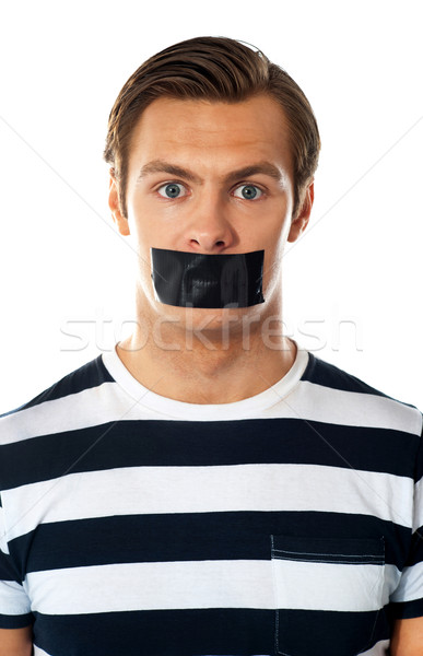 Man with duct tape over his mouth Stock photo © stockyimages