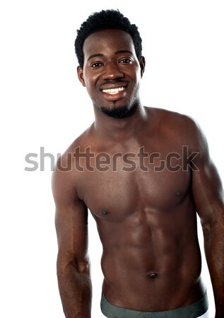 Shirtless young man posing in underwear Stock photo © stockyimages
