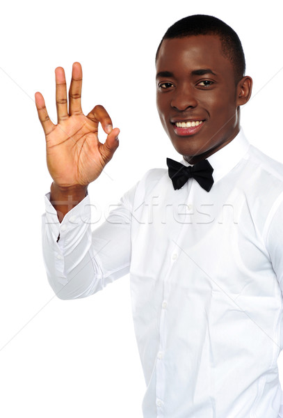 Young african boy showing okay gesture Stock photo © stockyimages