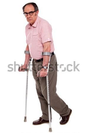 Uśmiechnięty starszych człowiek kule kalekiego biały medycznych Zdjęcia stock © stockyimages