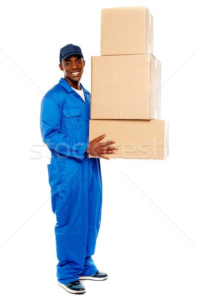 Genç teslim erkek karton kutuları Stok fotoğraf © stockyimages