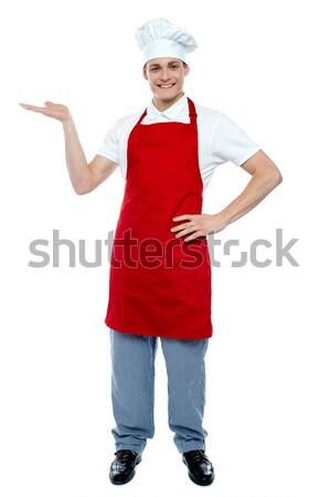 Retrato masculino chef vermelho uniforme posando Foto stock © stockyimages