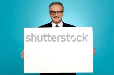 Negócio representante anúncio conselho sorridente Foto stock © stockyimages