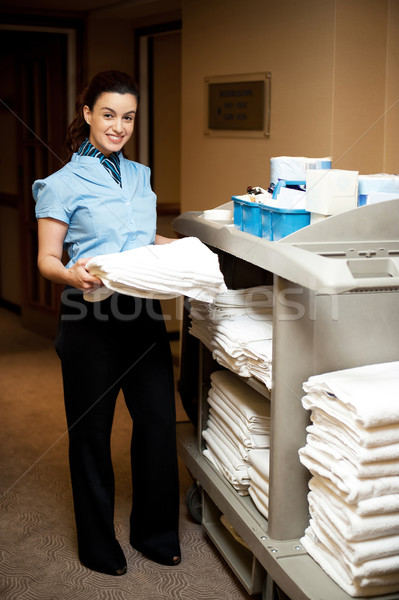 Full length portrait of executive holding bath towel Stock photo © stockyimages