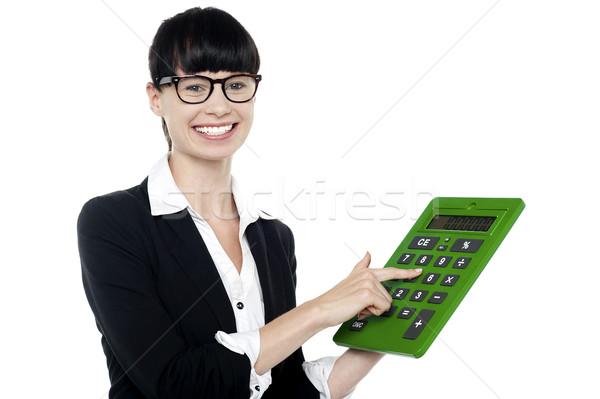 женщину большой зеленый калькулятор улыбающаяся женщина Сток-фото © stockyimages