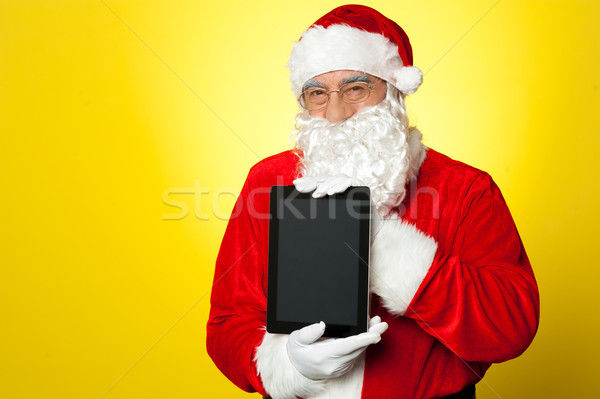 Babbo natale di recente tablet isolato Foto d'archivio © stockyimages